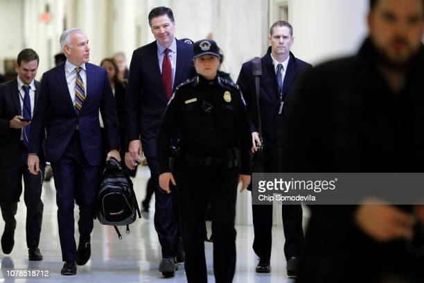 Former Federal Bureau of Investigation Director James Comey arrives at the Rayburn House Office Building before testifying to the House Judiciary and...