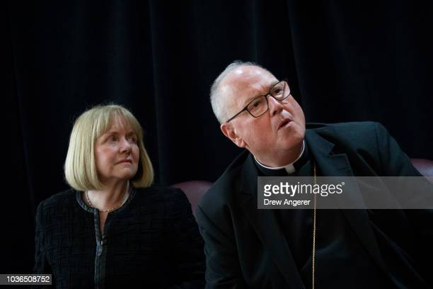 Former federal judge Barbara Jones speaks as Cardinal Timothy Dolan archbishop of New York prepares to exit following a news conference at the...