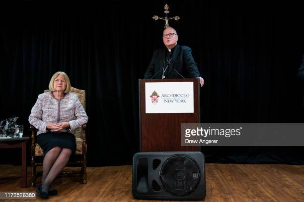 Former federal judge Barbara Jones looks on as Cardinal Timothy Dolan, Archbishop of New York, speaks during a news conference regarding the response...