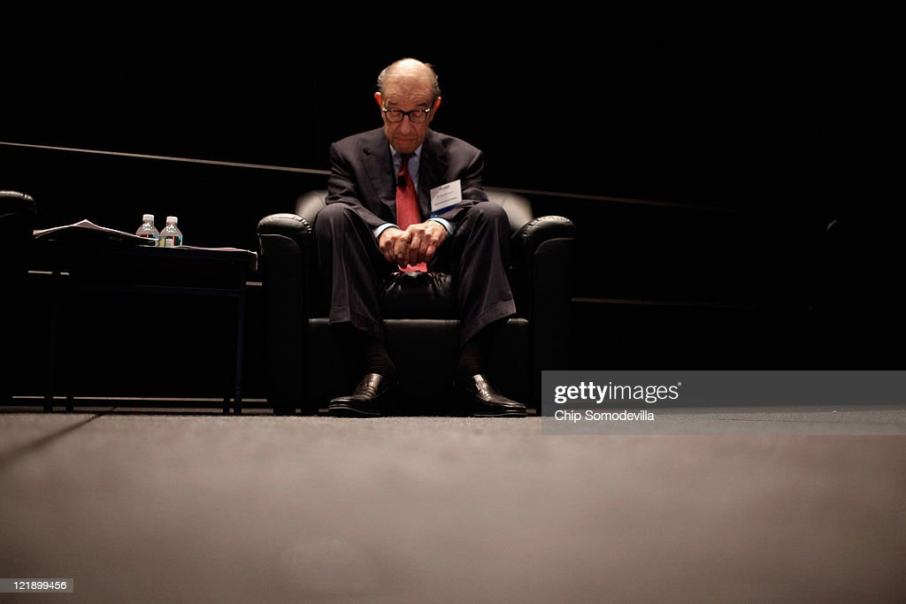 Former Federal Reserve Bank Chairman Alan Greenspan sits during a