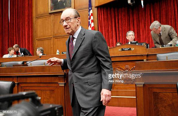 Former Federal Reserve Board Chairman Alan Greenspan returns to his seat after he greeted commission members prior to a hearing before the Financial...
