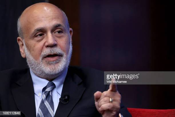Former Federal Reserve Board Chairman Ben Bernanke answers questions at a conference with former US Treasury Secretary Timothy Geithner and former US...