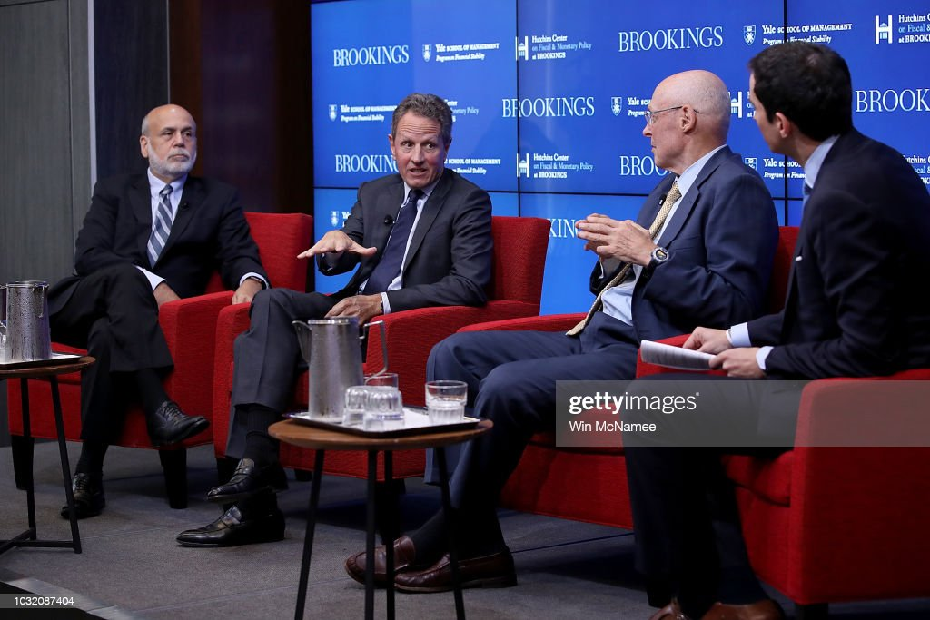 Former Federal Reserve Board Chairman Ben Bernanke, former Treasury Secretary Timothy Geithner and former Treasury Secretary Hank Paulson answer questions at the Brookings Institution September 12, 2018 in Washington, DC. The three participated in a conference on 'Responding to the Global Financial Crisis: What We Did and Why We Did It.' Also pictured is the conference moderator, New York Times columnist Andrew Ross Sorkin (R).