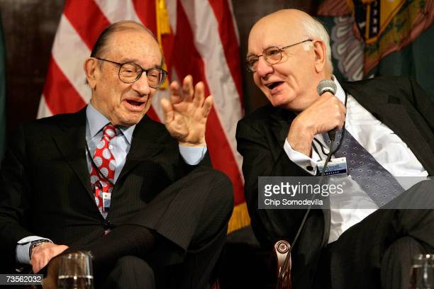 Former Federal Reseve System chairmen Alan Greenspan of Greenspan Associates and Paul Volcker share a laugh while participating in a panel discussion...