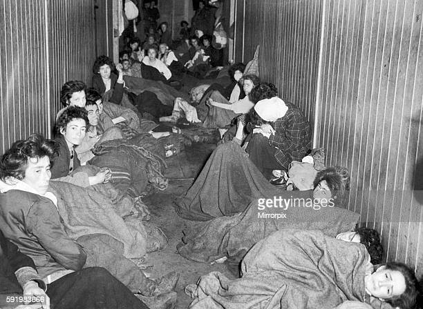 Former female and child prisoners of Bergen Belsen concentration camp crowded together in the so called hospital of the camp after it was liberated...