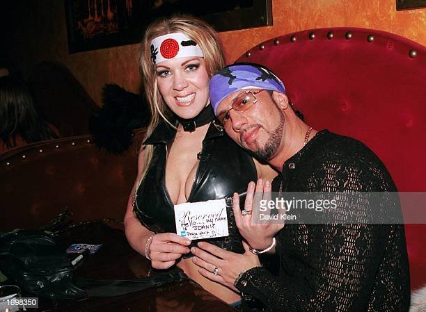 Former female wrestler Joanie Laurer poses with fiance wrestler Sean Waltman during Barfly 5th year anniversary party on December 18 2002 in West...