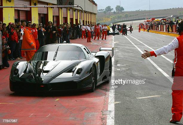 Former Ferrari driver Micheal Schumacher drives the Ferrari FXX during the Ferrari Day event at the Mugello racetrack near Florence 28 October 2007...