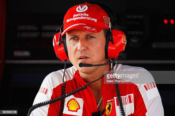 Former Ferrari F1 World Champion Michael Schumacher of Germany is seen in the pitlane during practice for the Italian Formula One Grand Prix at the...