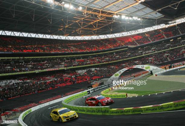 Former Ferrari Formula One World Champion Michael Schumacher of Germany and Jenson Button of Great Britain and Honda Racing compete during the...