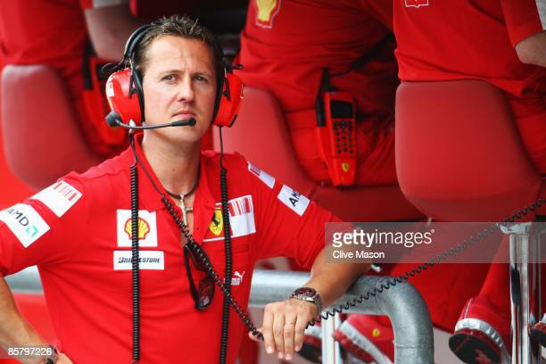 Former Ferrari Formula One World Champion Michael Schumacher of Germany is seen on the Ferrari pitwall before qualifying for the Malaysian Formula...