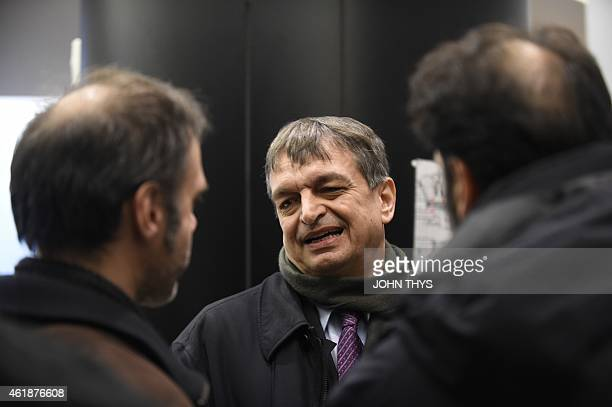 Former FIFA deputy general secretary Jerome Champagne speaks to people before a summit on FIFA at the European Union headquarters in Brussels on...