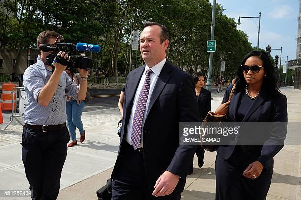 Former FIFA vice president Jeffrey Webb's lawyer Edward O'Callaghan and Webb's wife Kendra GambleWebb leave the federal court house in Brooklyn...