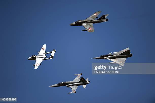 Former fighter jets of the Swiss Air Force the De Havilland Vampire the Hawker Hunter the Northrop F5 Tiger and the Dassault Mirage III perform...