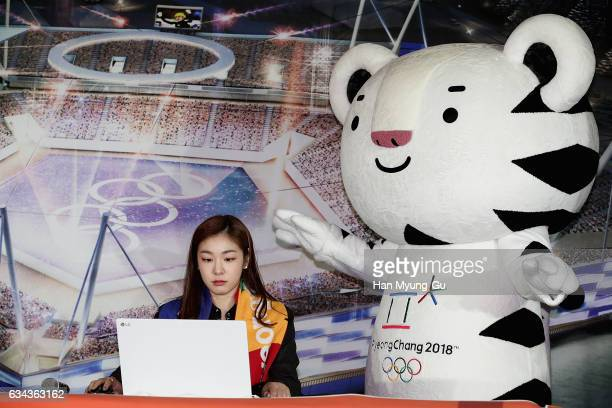 Former figure skater Yuna Kim and Pyeongchang Anticipates 2018 Winter Olympics mascots Soohorang attend the Ticket Sales Launch Event at the...