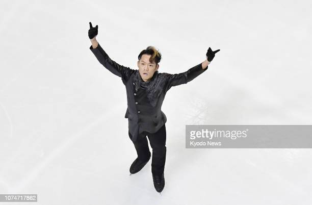 Former figure skating world champion and men's Vancouver Olympic bronze medalist Daisuke Takahashi reacts after his free program at Japan's national...