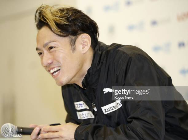 Former figure skating world champion and men's Vancouver Olympic bronze medalist Daisuke Takahashi meets the press after getting silver at Japan's...