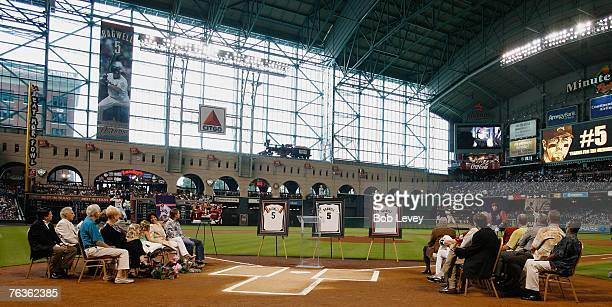 Former first baseman Jeff Bagwell of the Houston Astros along with family friends and former players watch a video tribute during his jersey...