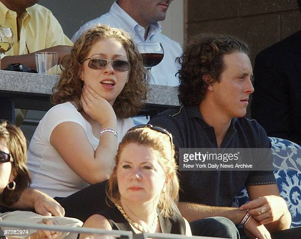 Former First Daughter Chelsea Clinton and boyfriend Ian Klaus take in the action at the 2002 US Open men's finals match at Arthur Ashe Stadium in...