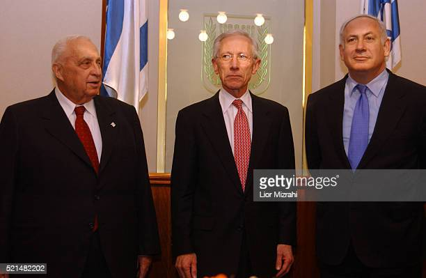 Former first deputy managing director of the International Monetary Fund , Stanley Fischer , poses with Israeli Prime Minister Ariel Sharon and...