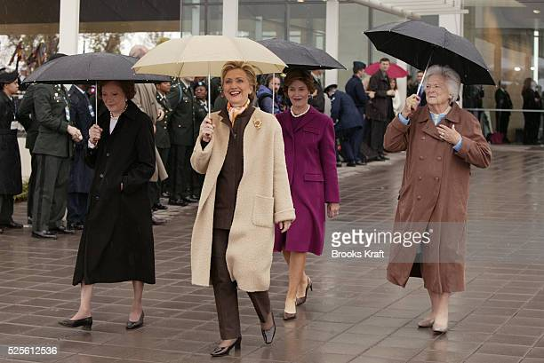 Former first ladies Rosalynn Carter Hillary Clinton current first lady Laura Bush and former first lady Barbara Bush at the dedication of the William...