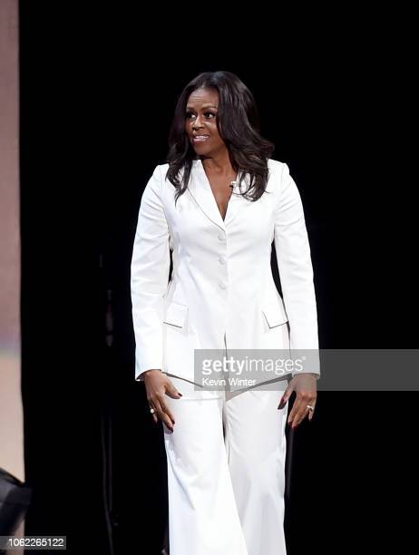 Former First Lady and author Michelle Obama appears onstage at Becoming An Intimate Conversation with Michelle Obama at the Forum on November 15 2018...