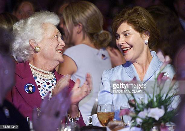 Former First Lady Barbara Bush applauds for her daughterinlaw Laura Bush during a tribute to Laura Bush held by the National Federation of Republican...