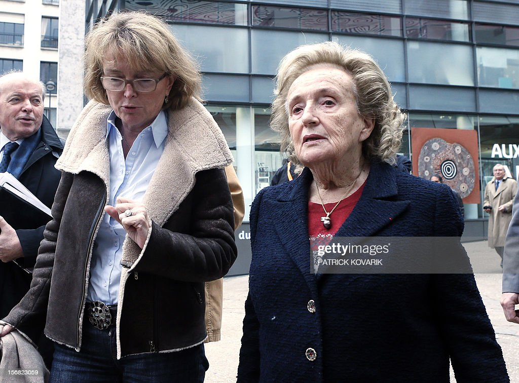 Former First lady, Bernadette Chirac (R) and her daughter Claude Chirac leave after the ceremony of release of the Jacques Chirac Foundation's 2012 Award for the prevention of conflicts, on November 22, 2012 at the Quai Branly Museum in Paris.