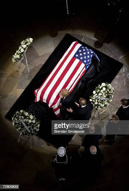 Former first lady Betty Ford wife of former US President Gerald Ford places her hand on his casket while their son Jack Ford supports her during...