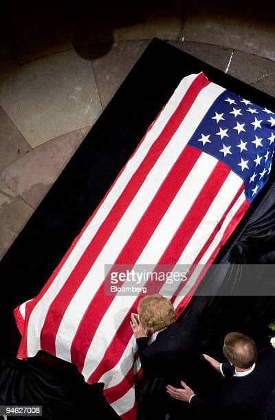 WASHINGTON DECEMBER 30 Former first lady Betty Ford wife of former US President Gerald Ford places her hand on his casket while their son Jack Ford...