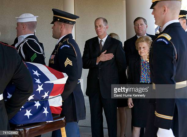 Former First Lady Betty Ford with sons Steve Ford and Jack Ford behind her watch the casket bearing former President Gerald R Ford into a prayer...