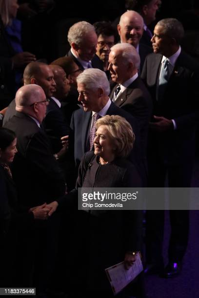 Former first lady Hillary Clinton, former President Bill Clinton, former Vice President Joe Biden and former President Barack Obama greet members of...
