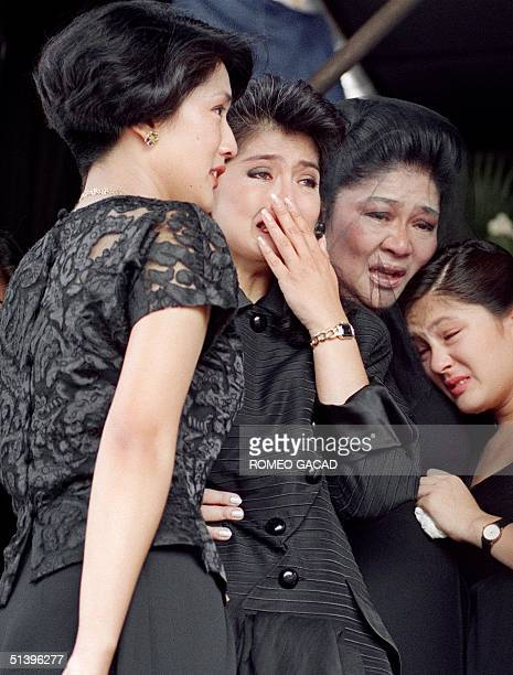 Former first lady Imelda Marcos and children Irene Araneta Imee Manotoc and adopted daughter Aimee breaks into tears 09 September during a public...