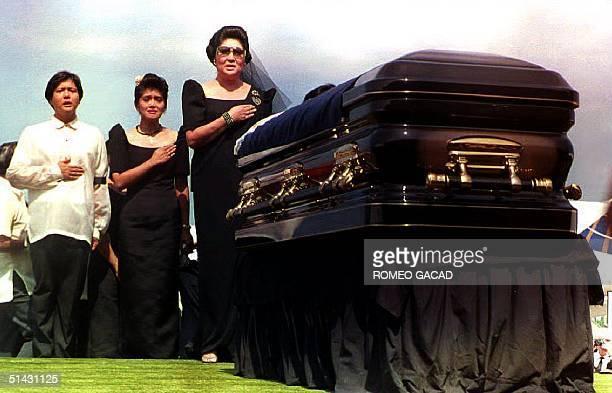 Former first lady Imelda Marcos with children Congressman Ferdinand Marcos Junior , Imee Manotoc singing the Philippine national anthem before the...