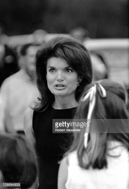 Former First Lady Jackie Kennedy walks toward the grave sites of her husband John Kennedy and brotherinlaw Robert Kennedy at Arlington National...
