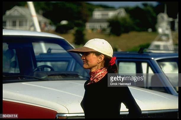 Former First Lady Jacqueline Kennedy Onassis poised smiling while hosting vacationing Pres Clinton family