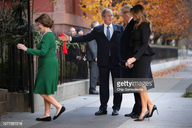 Former first lady Laura Bush and former President George W Bush greet first lady Melania Trump and President Donald Trump outside of Blair House...