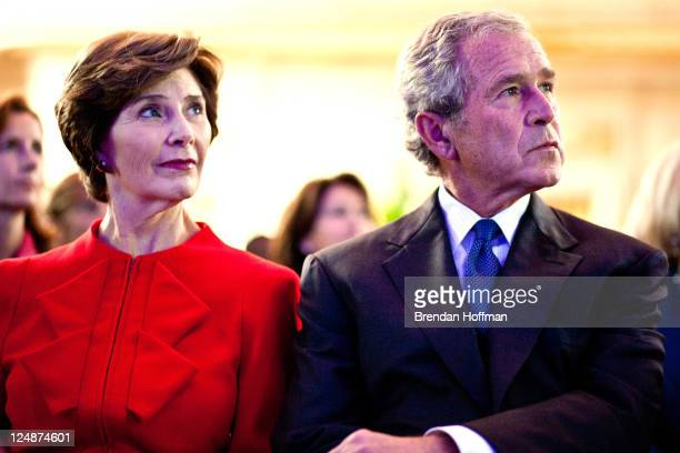 Former first lady Laura Bush and former President George W Bush watch a video at the Summit to Save Lives on September 13 2011 in Washington DC The...