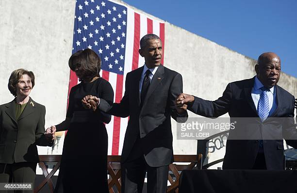 Former First Lady Laura Bush, First Lady Michelle Obama, US President Barack Obama and US Representative John Lewis, Democrat of Georgia, holds hands...