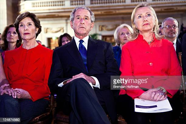 Former First Lady Laura Bush former President George W Bush and Secretary of State Hillary Clinton watch a video at the Summit to Save Lives on...