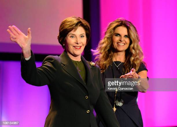 Former first lady Laura Bush is introduced by California first lady Maria Shriver during annual Women's Conference 2010 on October 26 2010 at the...