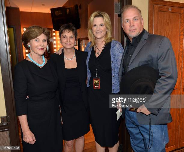Former First Lady Laura Bush Nancy Jones Trisha Yearwood and Garth Brooks attend the funeral service for George Jones at The Grand Ole Opry on May 2...
