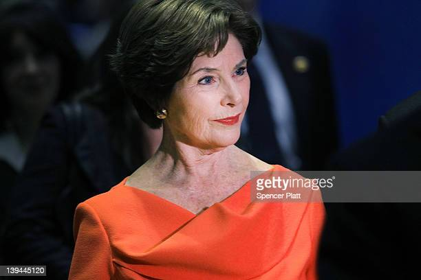 Former first lady Laura Bush walks through the floor of the New York Stock Exchange while on a visit to Ring The Opening Bell on behalf of the The...