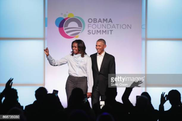Former first Lady Michelle and former president Barack Obama are introduced at the inaugural Obama Foundation Summit on October 31 2017 in Chicago...