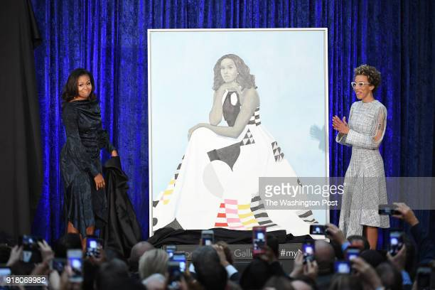 Former First Lady Michelle Obama and artist Amy Sherald stand next to Mrs Obama's portrait as she and former President Barack Obama have their...