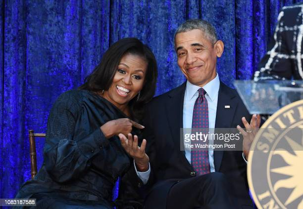 Former First Lady Michelle Obama and former President Barack Obama are seen after their portraits were unveiled at the Smithsonian National Portrait...
