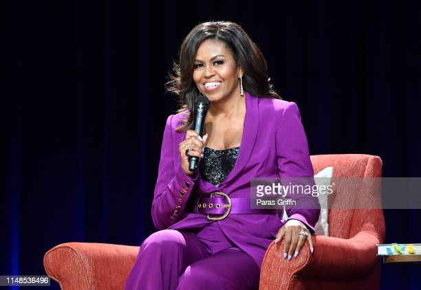 Former First Lady Michelle Obama attends 'Becoming: An Intimate Conversation with Michelle Obama' at State Farm Arena on May 11, 2019 in Atlanta,...