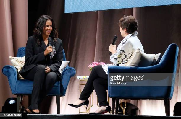 Former First Lady Michelle Obama discusses her new book 'Becoming' with moderator Valerie Jarrett at Capital One Arena on November 17 2018 in...