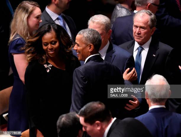 Former First Lady Michelle Obama former US President Barack Obama former Vice President Al Gore and former US President George W Bush arrive for the...