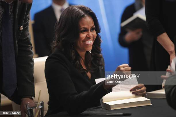 "Former first lady Michelle Obama kicks off her ""Becoming"" book tour with a signing at the Seminary Coop bookstore on November 13 2018 in Chicago..."