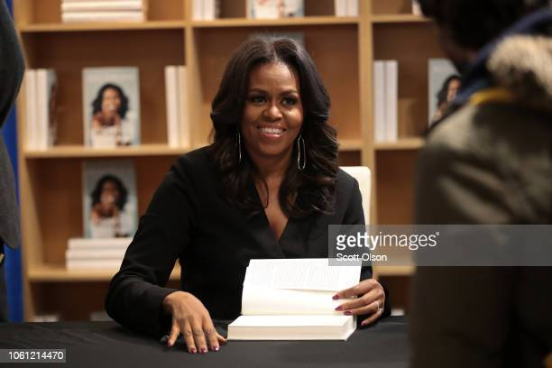 """Former first lady Michelle Obama kicks off her """"Becoming"""" book tour with a signing at the Seminary Coop bookstore on November 13 2018 in Chicago..."""